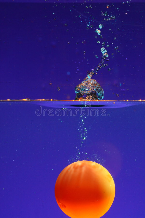 Ball submerged in water. Small ball submerged in water royalty free stock photography