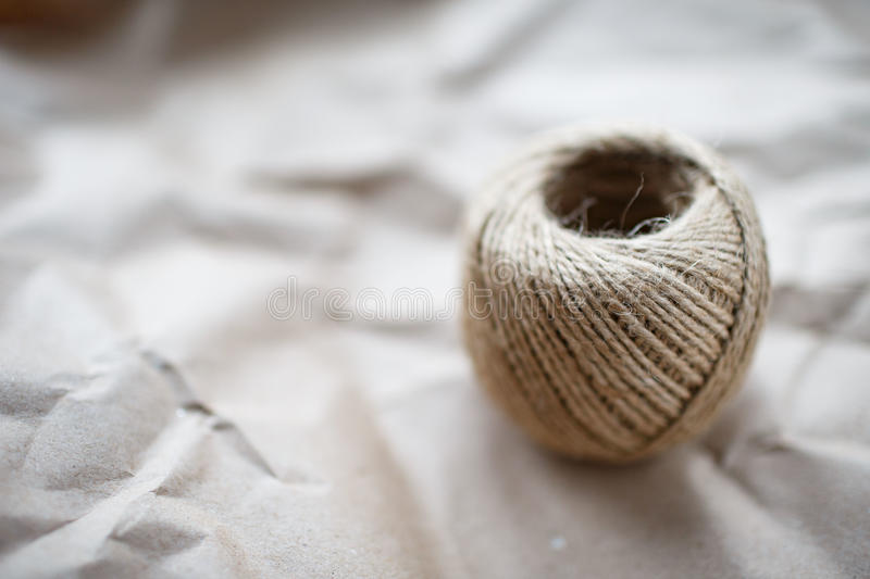 A ball of twine on kraft paper stock images