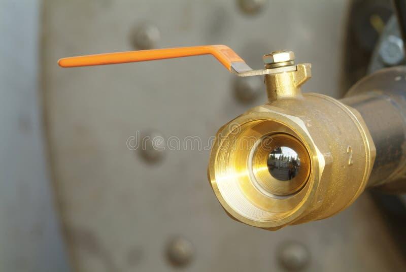 Ball valve with orange handle royalty free stock image