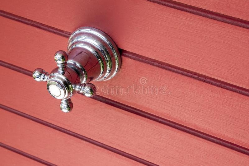 Ball valve with stainless steel handle, with red wall close. stock photo