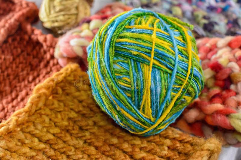 Ball of wool. Three colors on the tissue royalty free stock photos