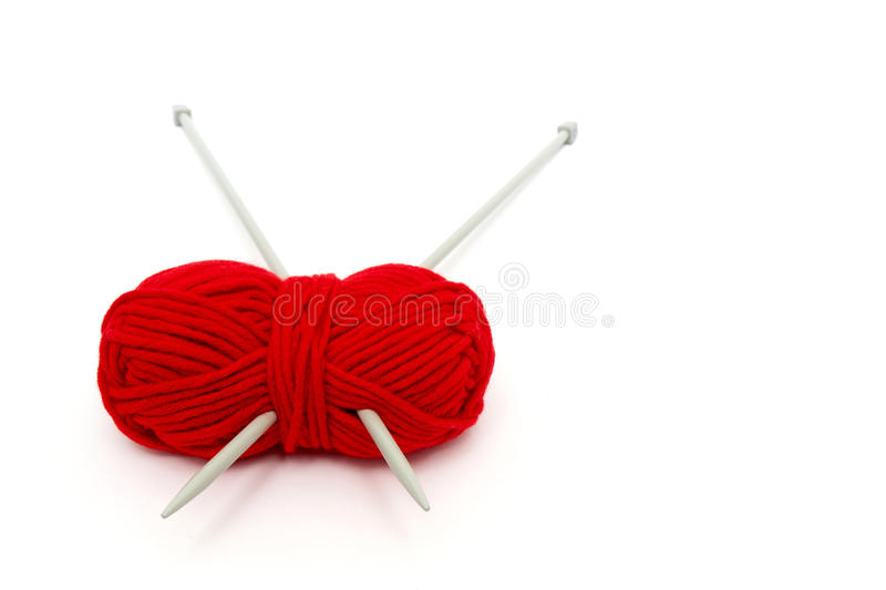 Ball of yarn with knitting needles. Isolated on white background stock images
