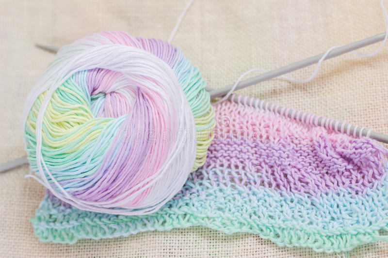 Ball of yarn with knitting needles. Multicolored ball of yarn with knitting needles royalty free stock photo