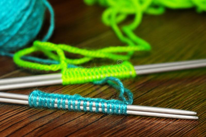 Ball of Yarn and Knitting Needles on wooden background stock photography