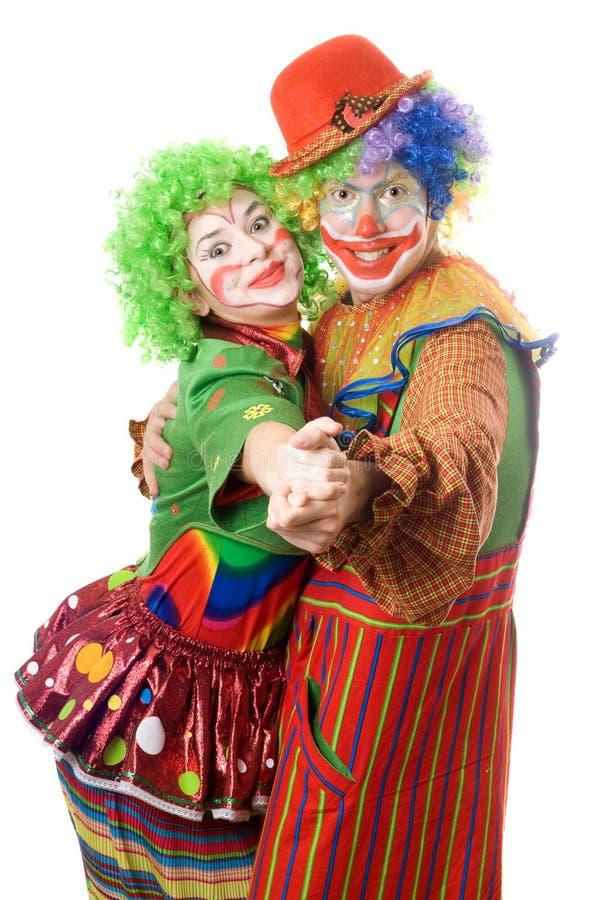 Ballare felice di una coppia di pagliacci fotografie stock libere da diritti