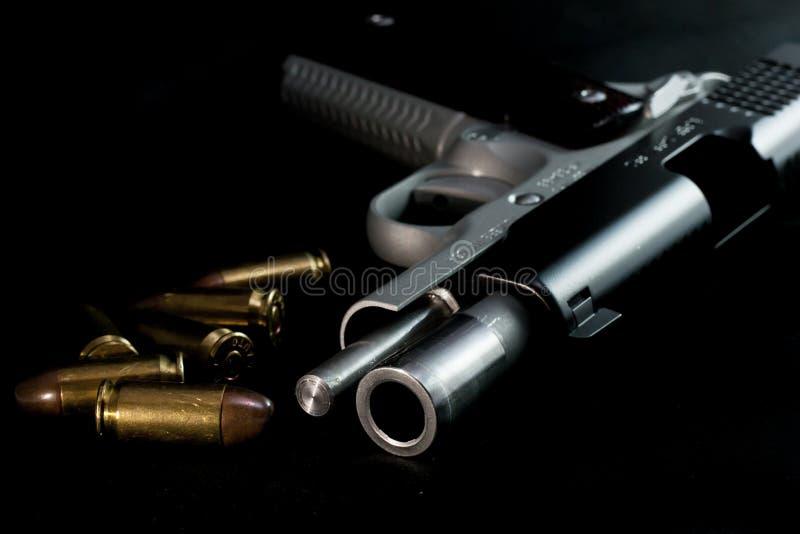 Balle d'armes à feu de pistolet de pistolet image stock