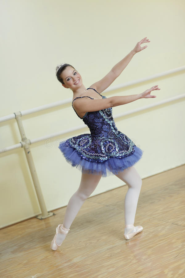Ballerina with arms outstretched stock photo