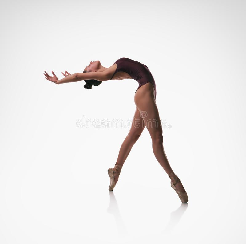 Ballerina. Bend back. The professional ballerina in pointe shoes in a bend back royalty free stock photo