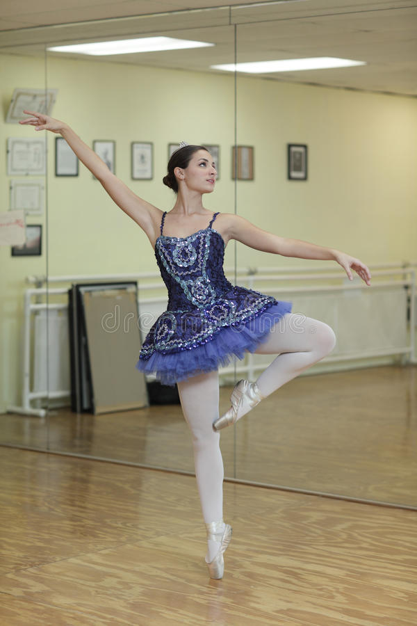 Ballerina in a blue tutu royalty free stock photography