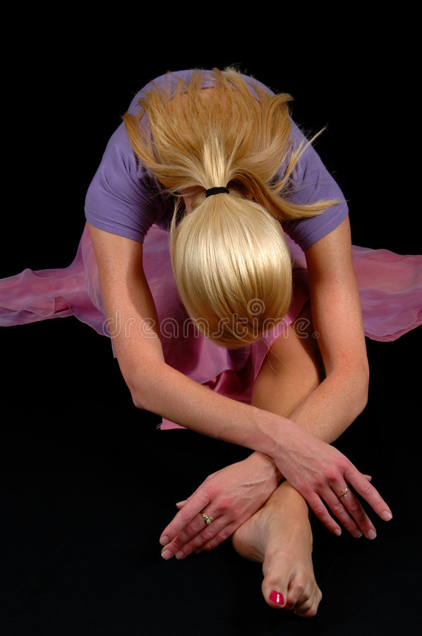 Ballerina Bowing. Isolated over a black background royalty free stock images