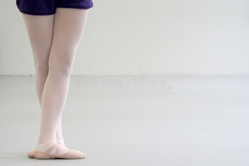 Ballerina with crossed feets standing royalty free stock photo
