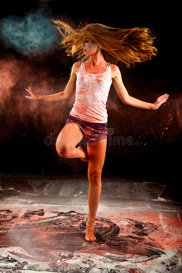 Ballerina dance girl spin pink blue flour royalty free stock photography