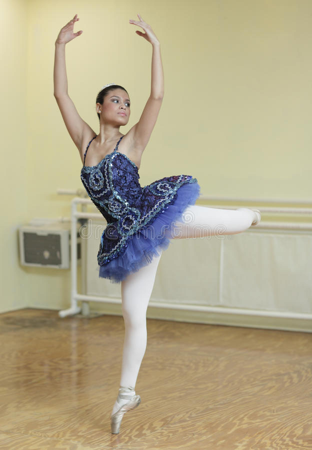 Ballerina in a dance studio stock images