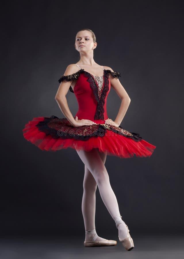 Ballerina dancer making a ballet pose royalty free stock images