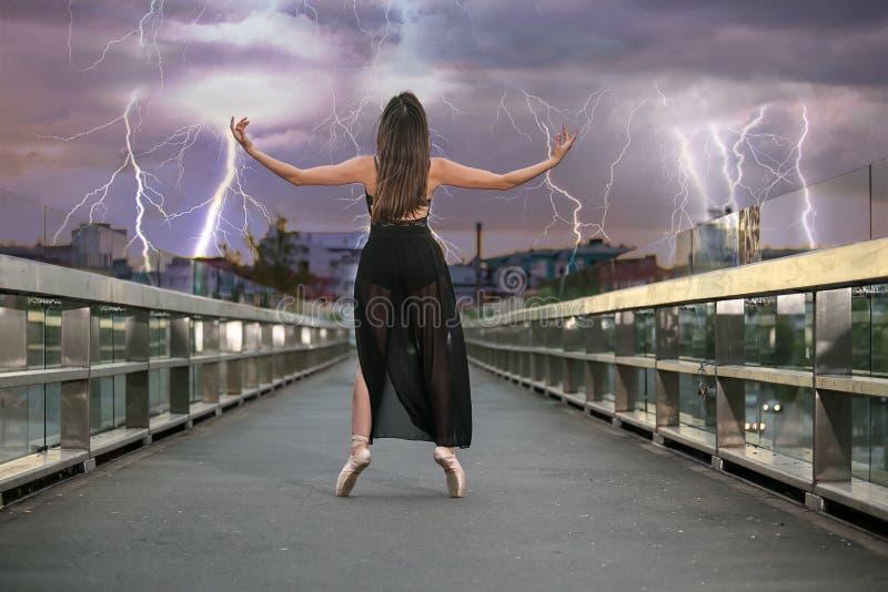 Ballerina dances on the bridge royalty free stock photography