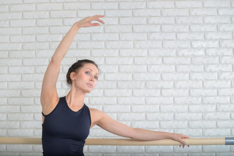 Ballerina dancing at ballet studio near barre, closeup portrait. stock images
