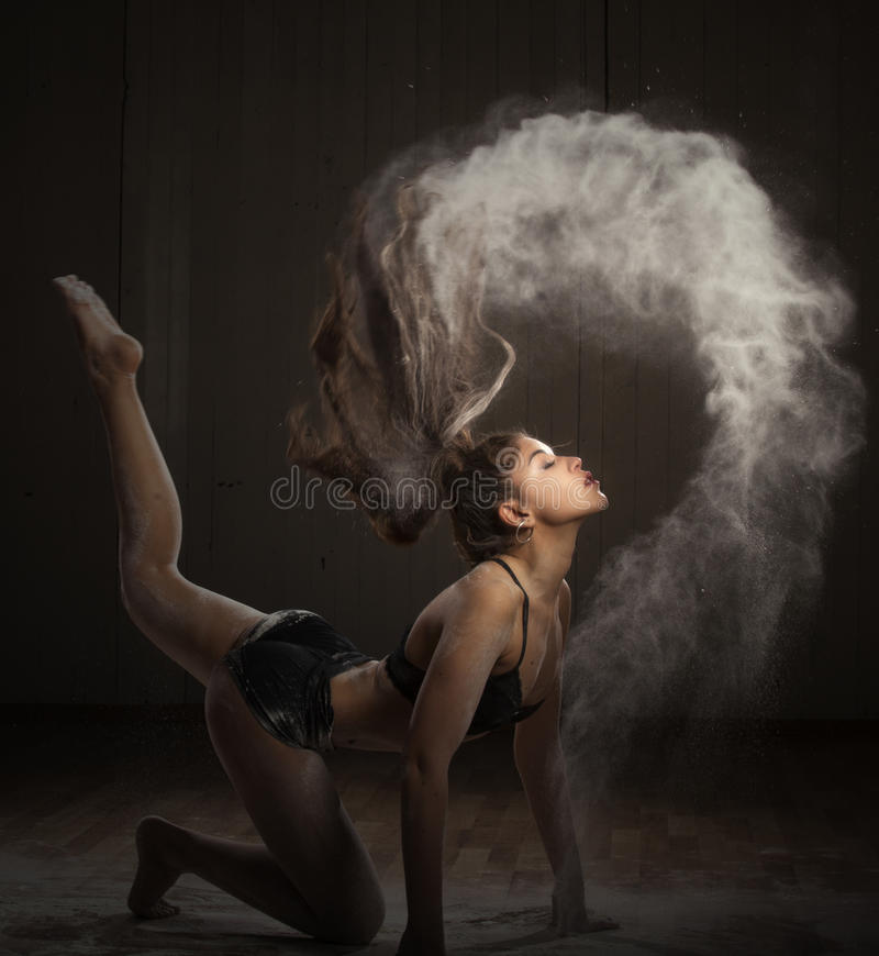 Ballerina dancing with flour royalty free stock photo