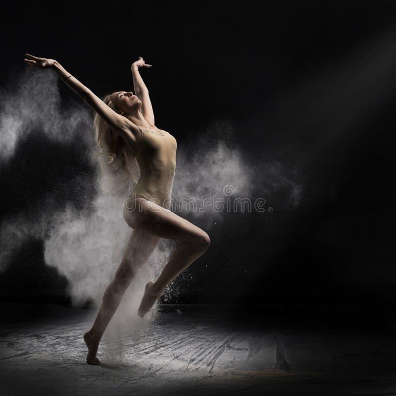 Ballerina dancing with flour stock photo