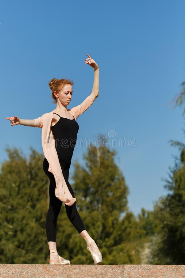 Ballerina dancing outdoors stock image