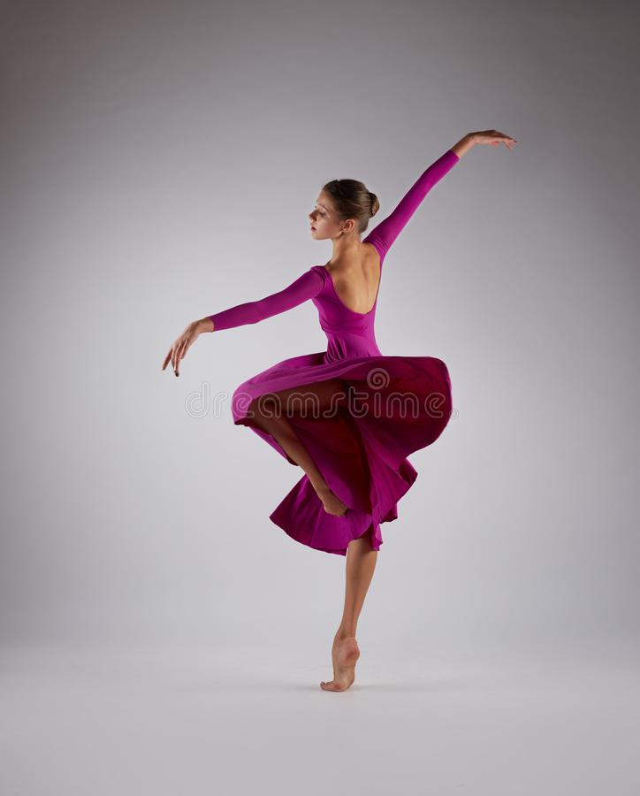 Ballerina dancing in pink flying dress royalty free stock photo