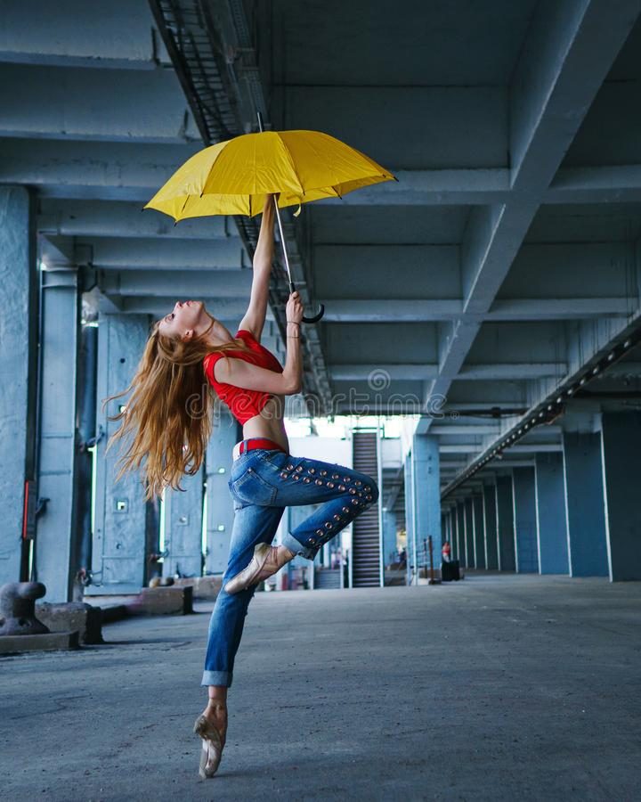 Ballerina dancing with umbrella. Street performance. stock photos