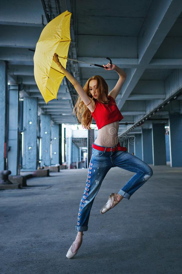 Ballerina dancing with umbrella. Street performance. stock photo
