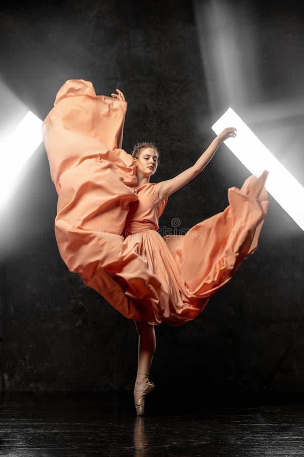 Ballerina demonstrates dance skills. Beautiful classic ballet. stock photo
