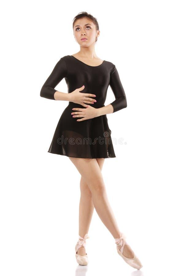 Ballerina die omhoog kijkt stock foto