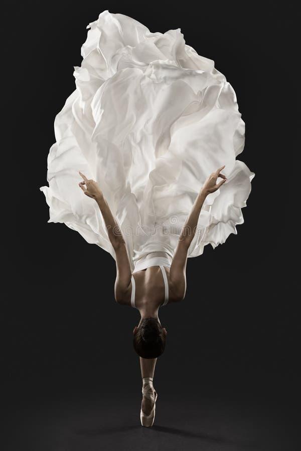 Free Ballerina Graceful Jump In White Silk Dress, Ballet Dancer Pointe Shoes In Fluttering Cloth Stock Photos - 206399913