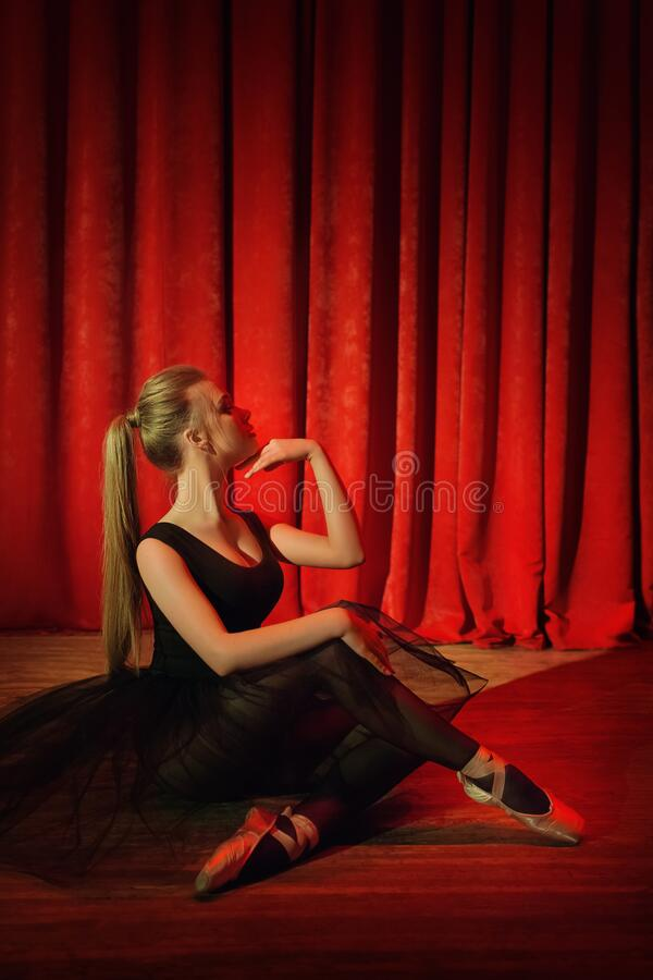 Free Ballerina In Black Clothes On A Red Stage Stock Images - 177964234