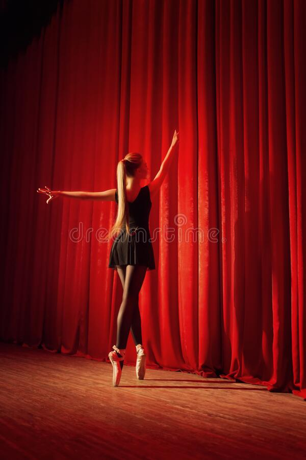 Free Ballerina In Black Clothes On A Red Stage Royalty Free Stock Image - 177964376