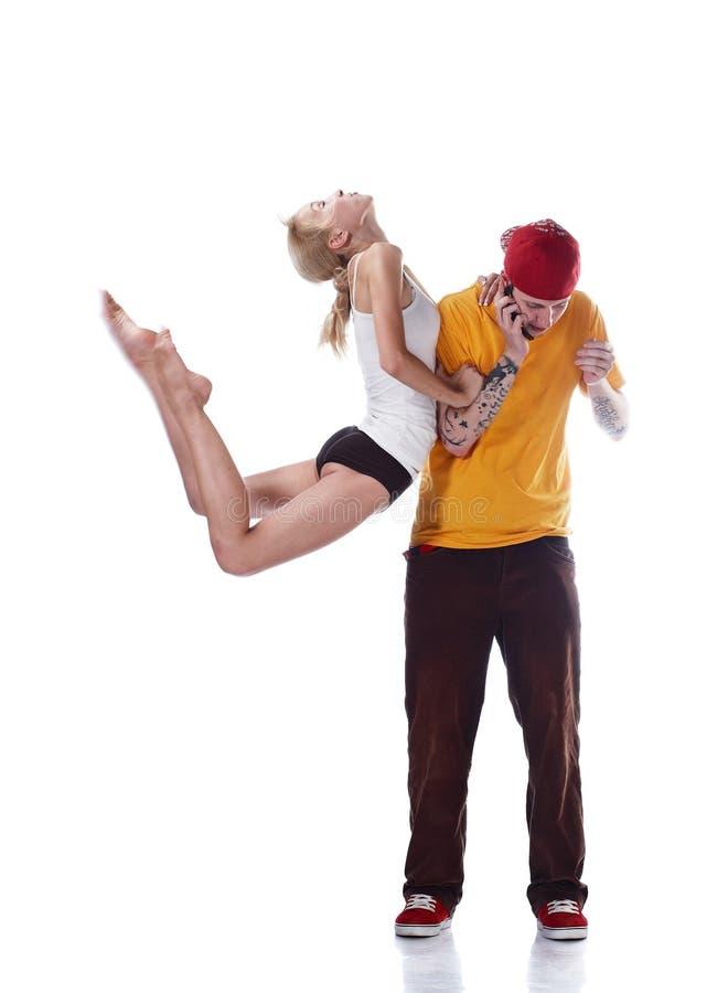 Ballerina jumping and hip hop dancer calling phone royalty free stock photography