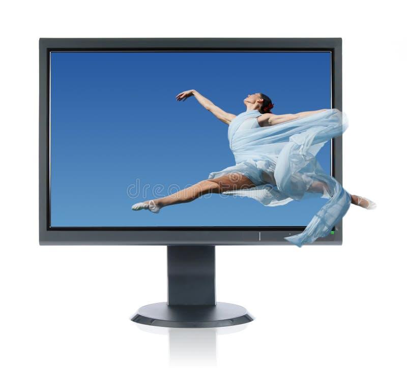 Ballerina Jumping Into A Monitor Royalty Free Stock Photography