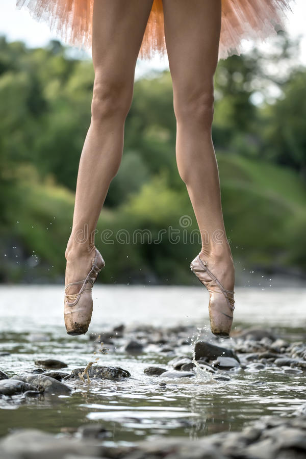 Ballerina jumping in river royalty free stock photo