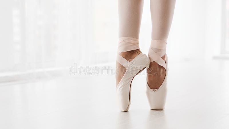 Ballerina Legs On Pointe Closeup. Classic And Modern Ballet Conc royalty free stock images