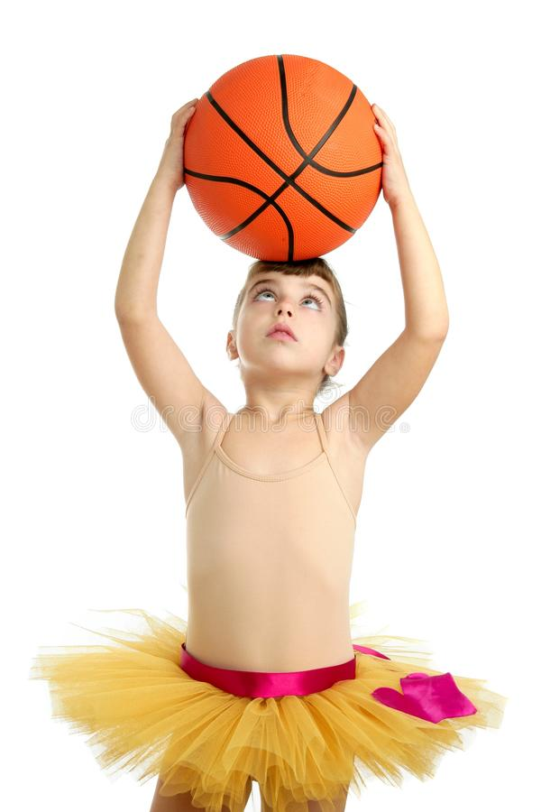 Ballerina little girl with basketball ball stock photography