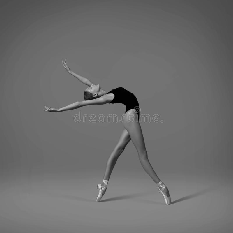 Ballerina makes a back arch. Black and white photo. stock image
