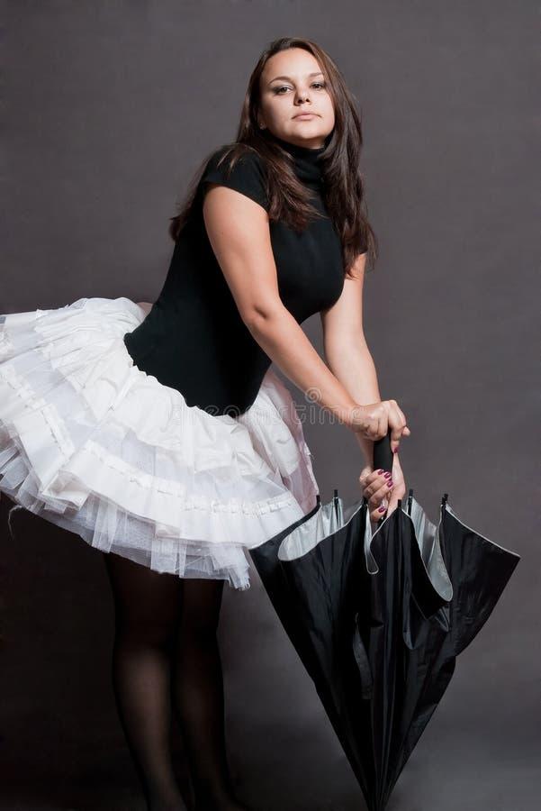 Ballerina mit Regenschirm stockfotografie