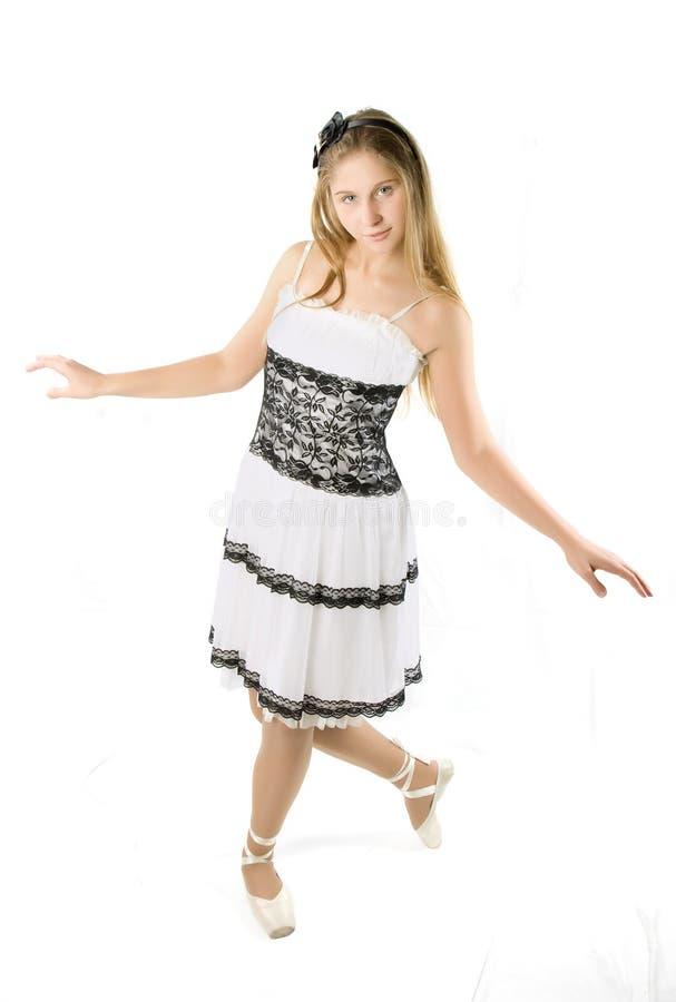 Ballerina op de witte achtergrond stock afbeeldingen
