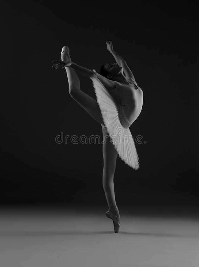 Ballerina in the pose `Swallow` royalty free stock image