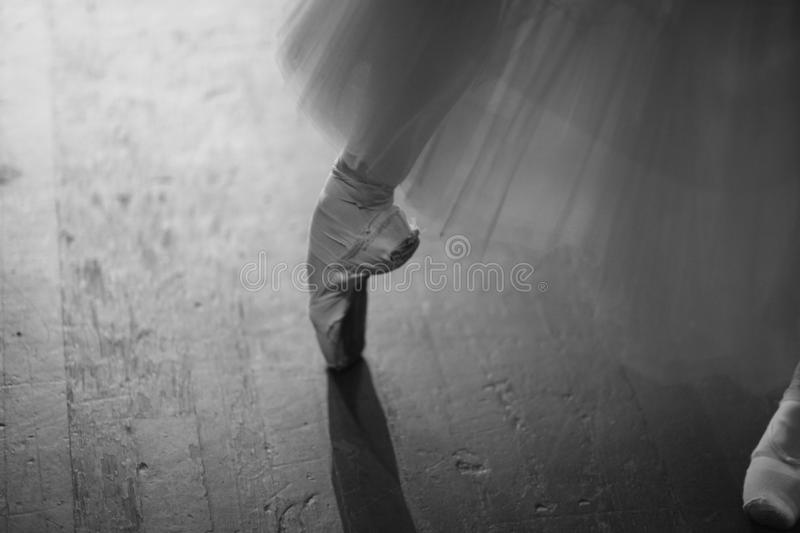 Ballerina in pointe shoes behind the scenes. Of the theater in anticipation of entering the stage royalty free stock images