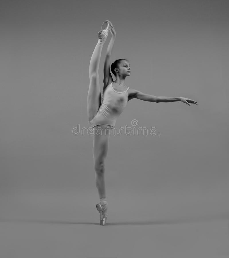 Ballerina in a pose a la seconde. The professional ballerina in pointe shoes in a pose a la seconde stock photography