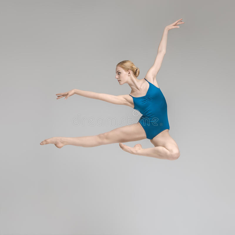 Ballerina posing in jump royalty free stock image