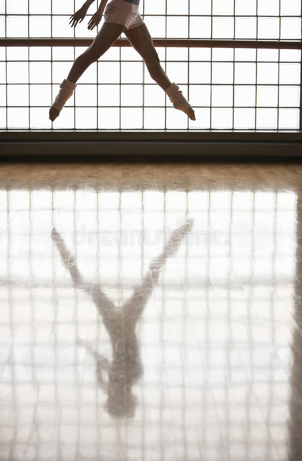 Ballerina Practicing In Rehearsal Room. Low section of ballerina practicing in rehearsal room stock images