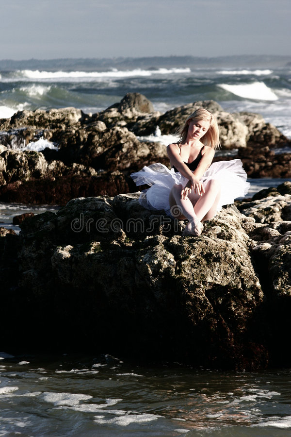 Ballerina on rocks stock images