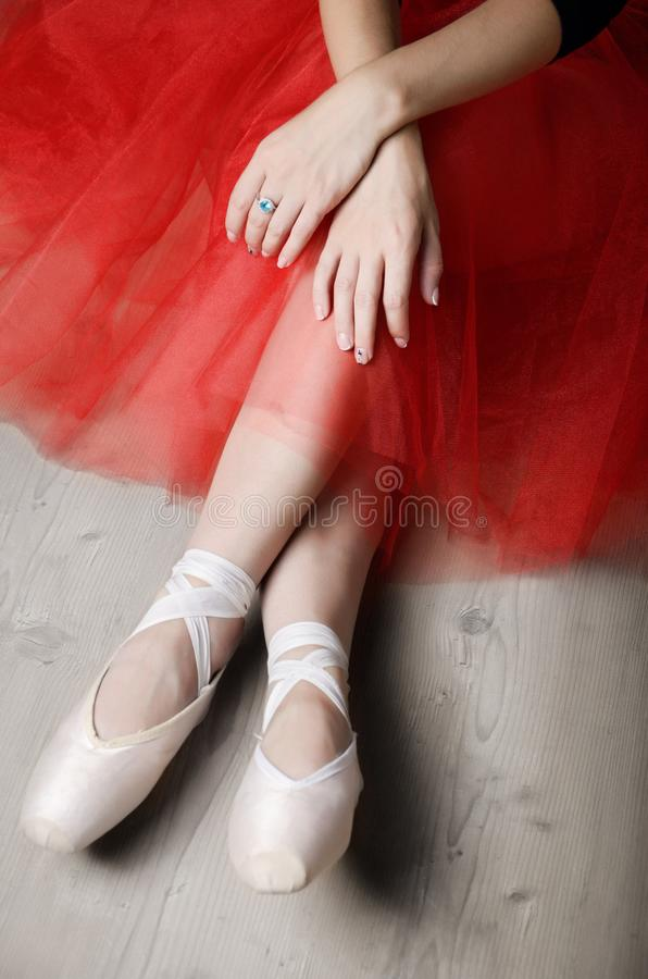 Ballerina`s crossed hands and feet while rest time.  royalty free stock image