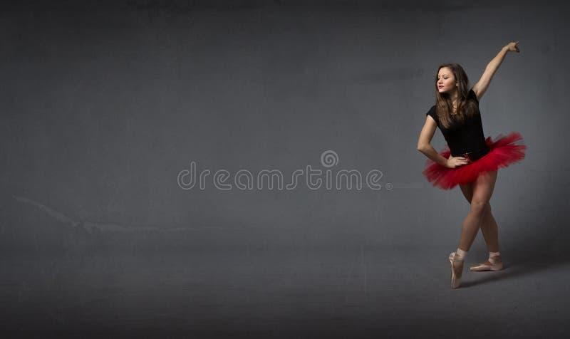 Ballerina saluting with elegance. Dark background stock photo