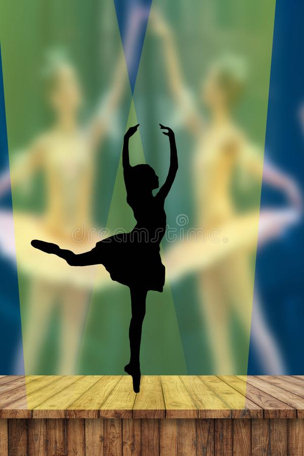 Ballerina silhouette dancing on pointe on stage in the spotlight in attitude derriere postion with two ballerinas on the backgroun royalty free illustration