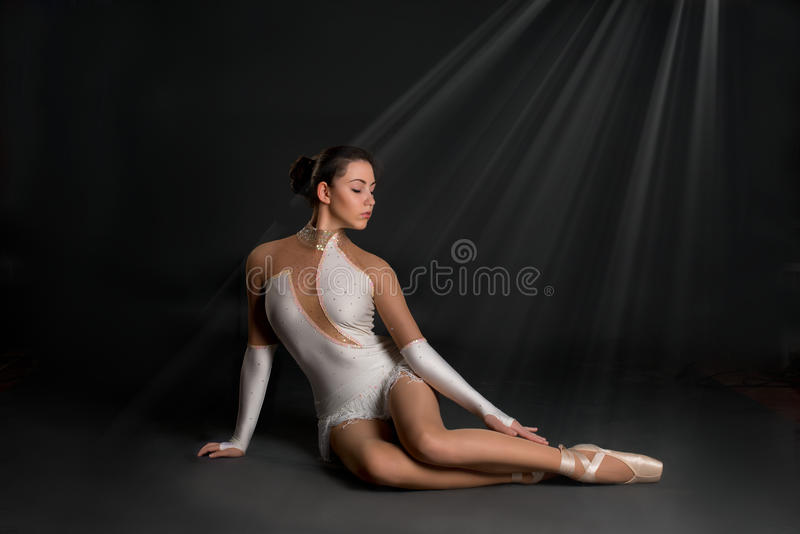 The ballerina sits and has a rest stock photos
