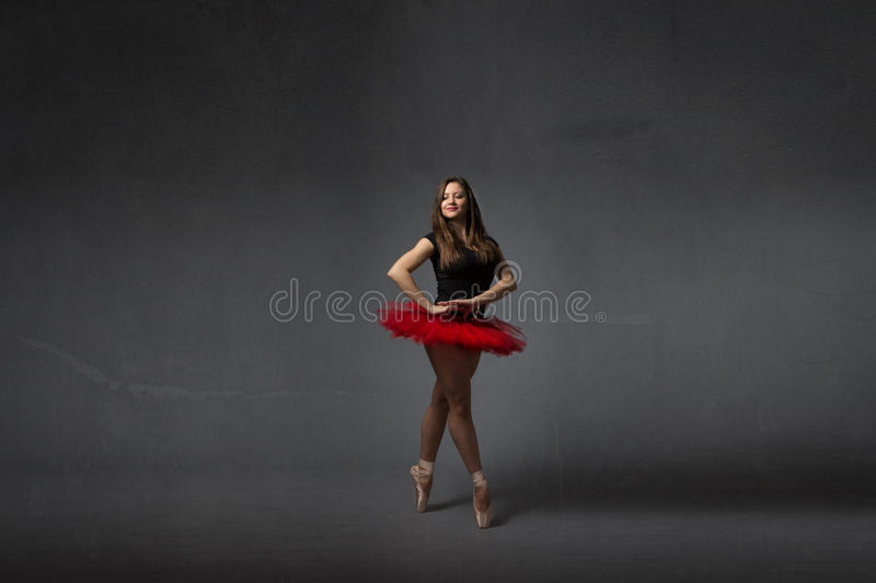 Ballerina smiling with red tutu royalty free stock photos